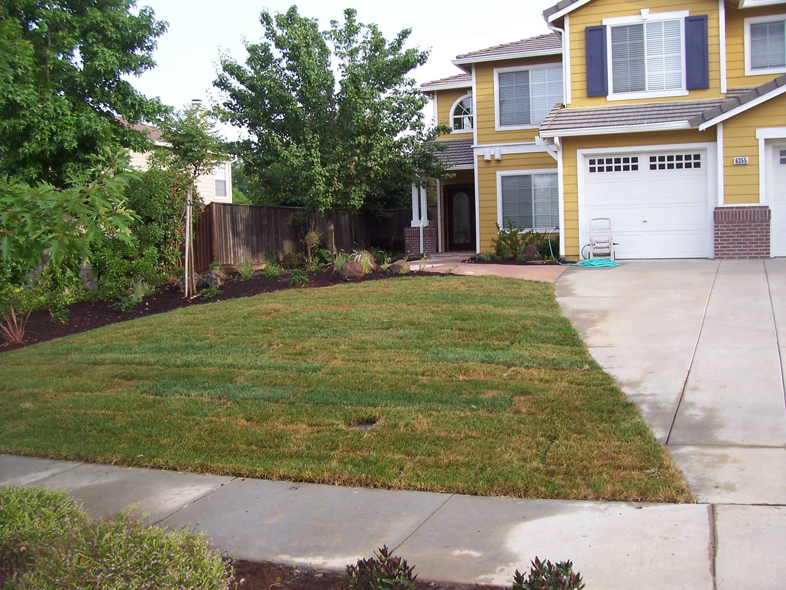 Sample 1 four seasons construction landscaping for Sample garden landscape